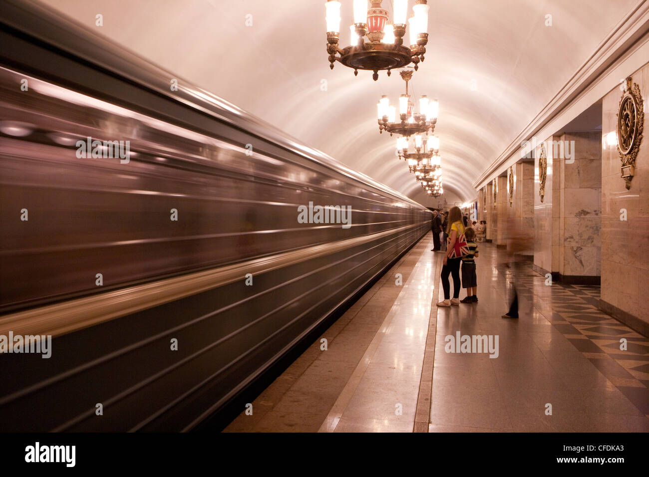 Train arrives at Metro underground rail station, St. Petersburg, Russia - Stock Image