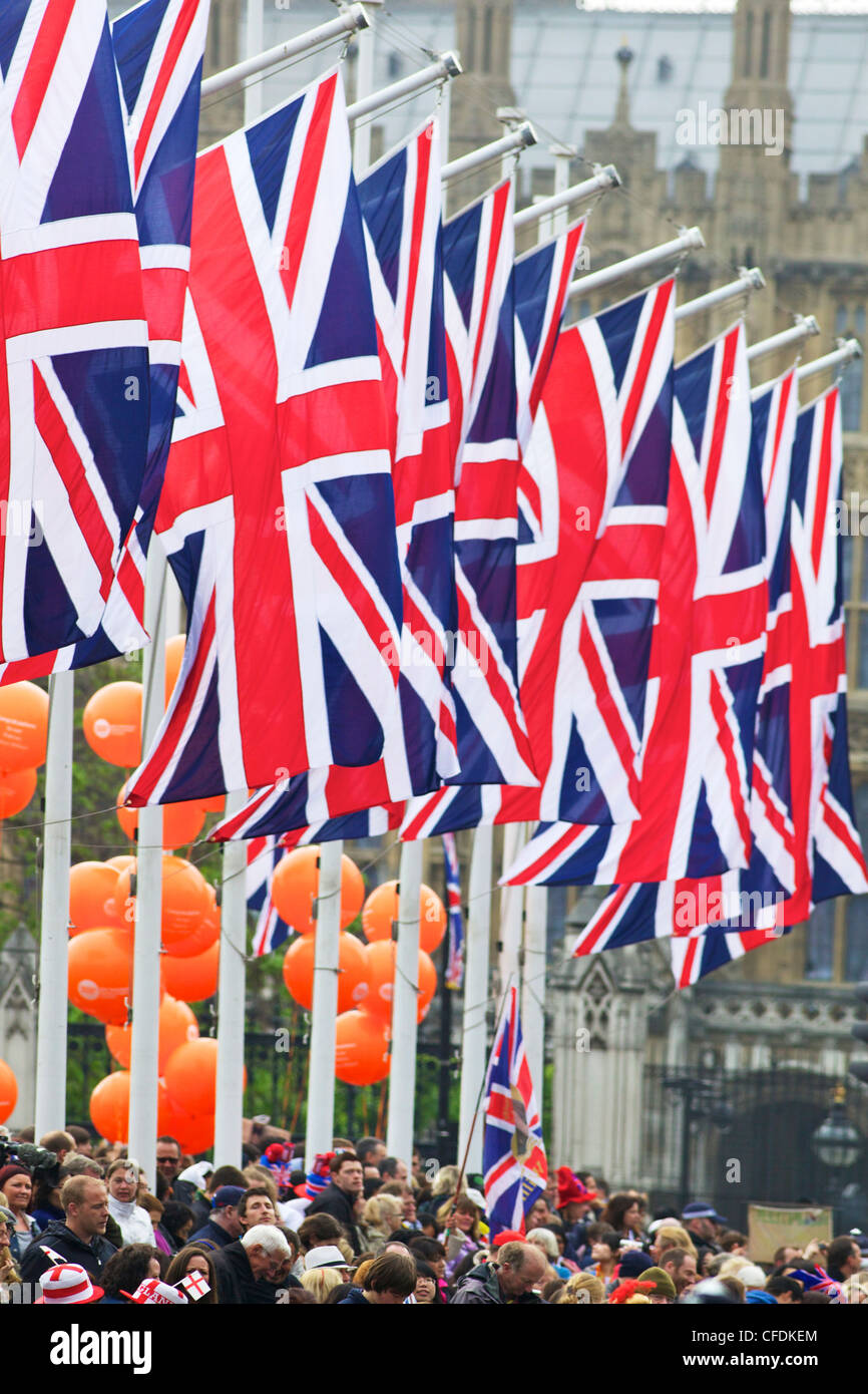 Flags and spectators outside Houses of Parliament, during the marriage of Prince William to Kate Middleton, London, - Stock Image