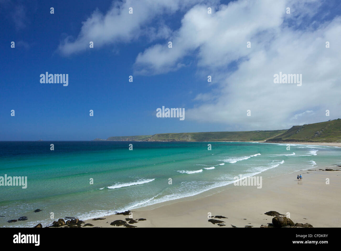 Young couple on beach at Sennen Cove in summer sunshine, West Penwith, Cornwall, England, United Kingdom, Europe - Stock Image