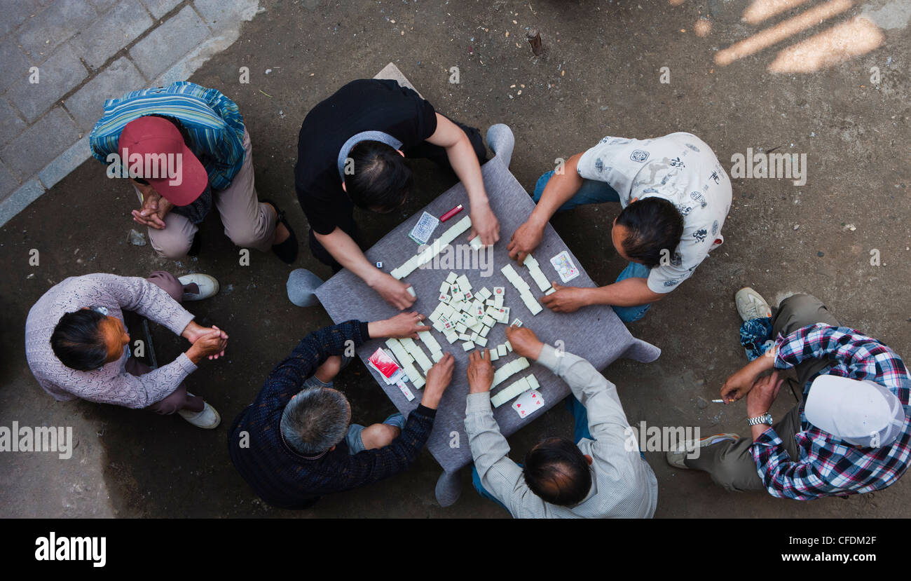 Overhead view of Chinese men sitting outdoors playing the traditional game  of mahjong, Hangzhou,