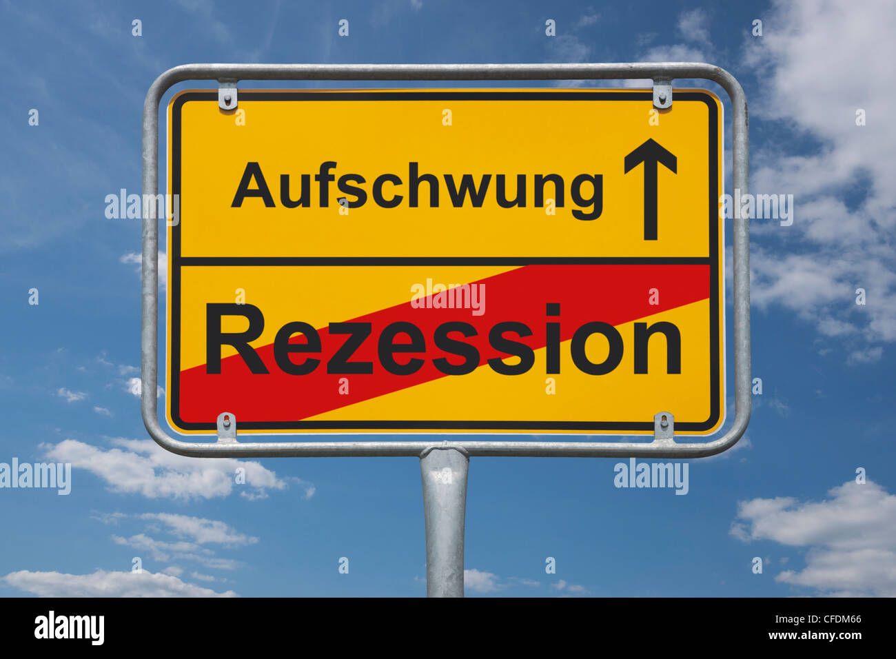 Town sign Germany, End of the town with the inscription end of downturn, beginning upswing, background sky. - Stock Image