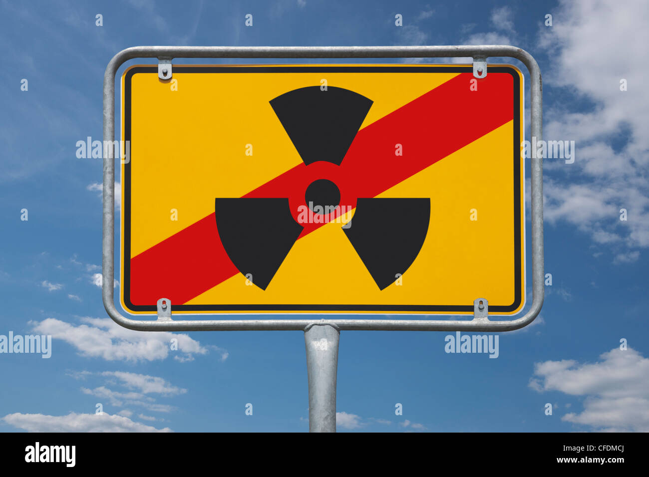 View of a end of the town sign with the symbol for radioactivity, background sky. - Stock Image