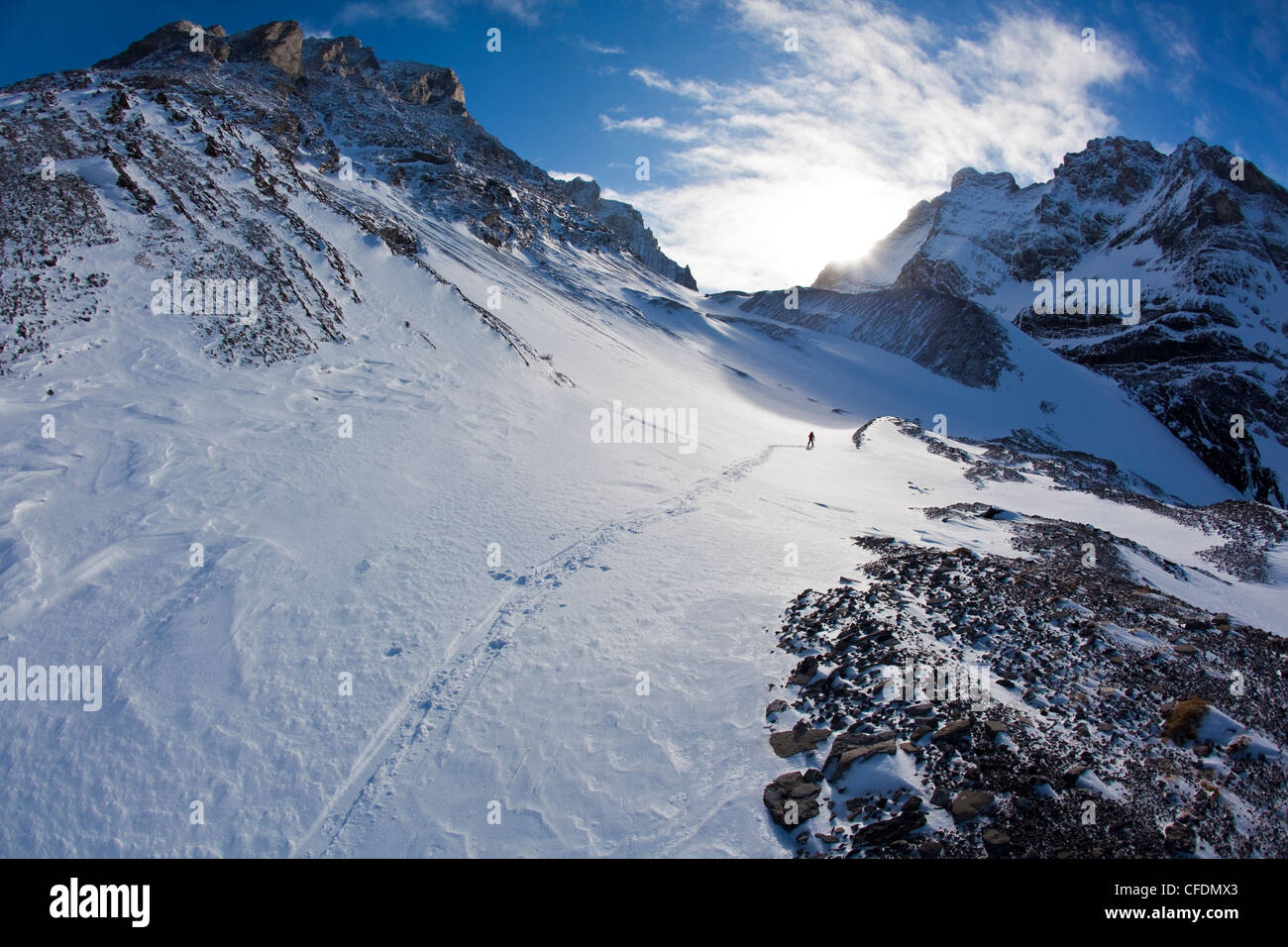 A man ski tours along the French/Haig Robertson Traverse, Peter Lougheed Provinicial Park, Kananaskis, Alberta, - Stock Image