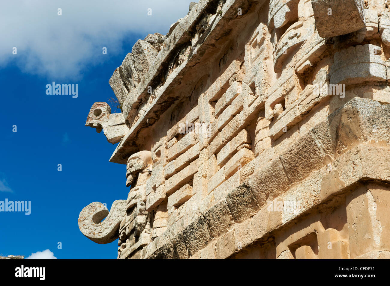 Mask of Chac Mool, god of the rain, on the church in the ancient mayan ruins of Chichen Itza, Yucatan, Mexico - Stock Image
