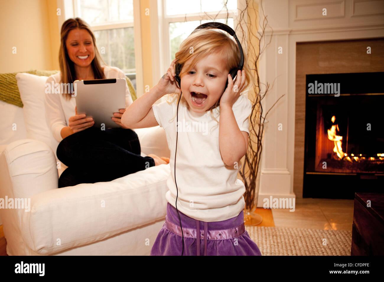 3 year old girl singing. - Stock Image