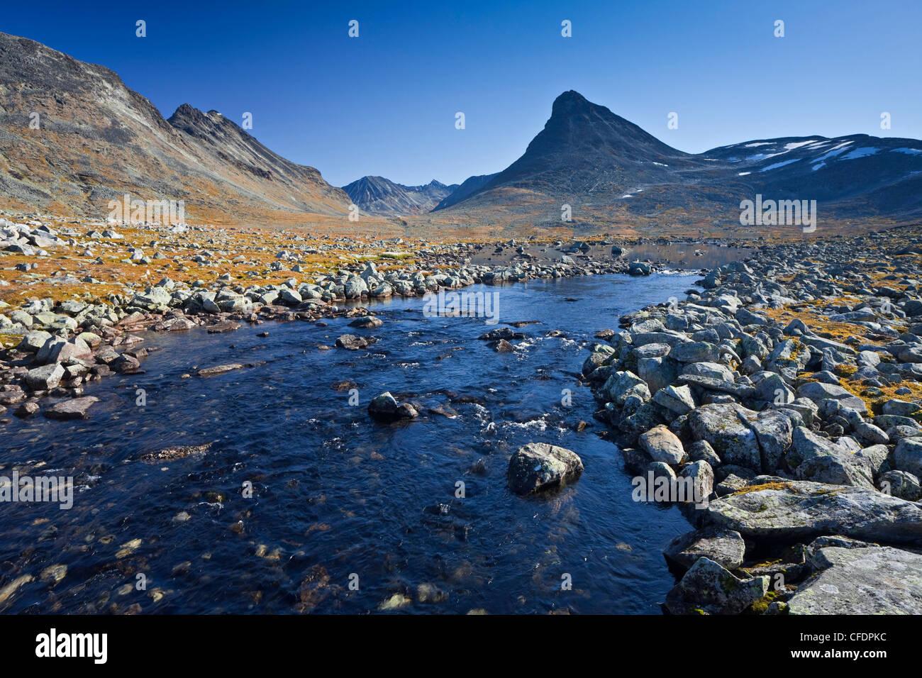 Leira river under blue sky, Jotunheimen National Park, Kyrkja, Norway, Europe - Stock Image