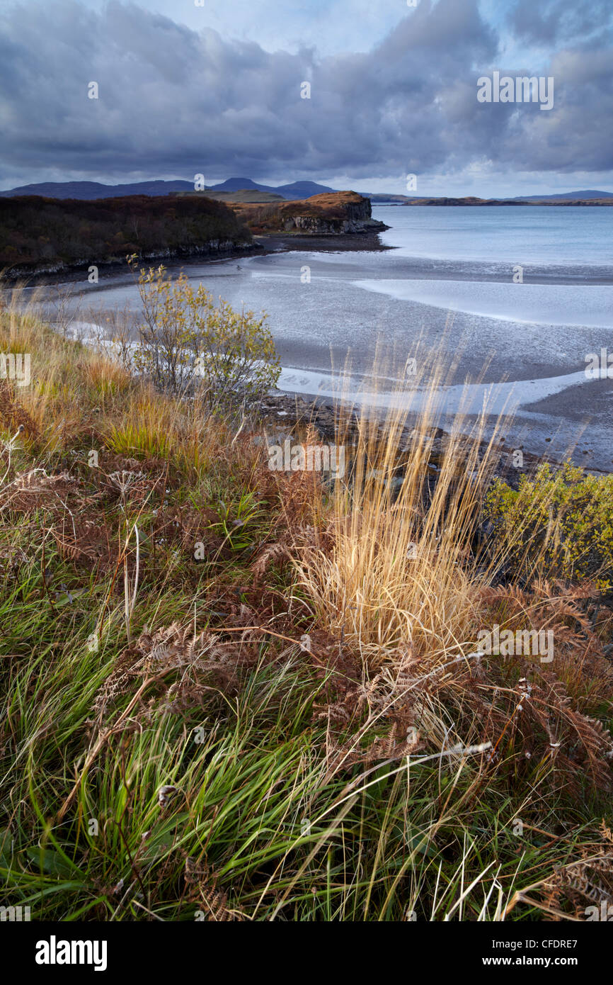 The view from Fiskavaig Bay across Loch Bracadale with the distinctive mountains MacLeod's tables in the distance, Scotland, UK Stock Photo