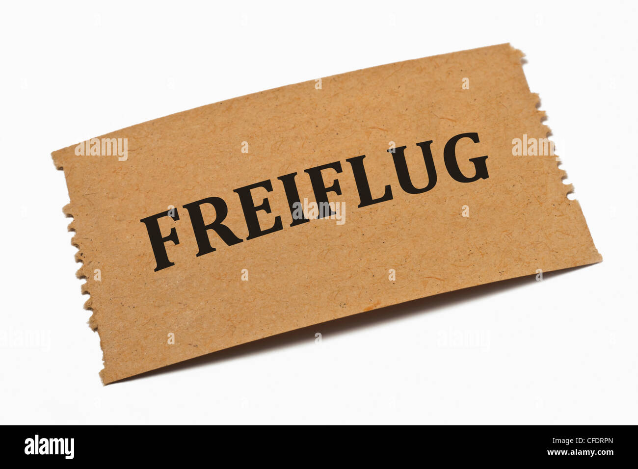 Detail photo of a paper card with the inscription Freiflug (free flight) - Stock Image