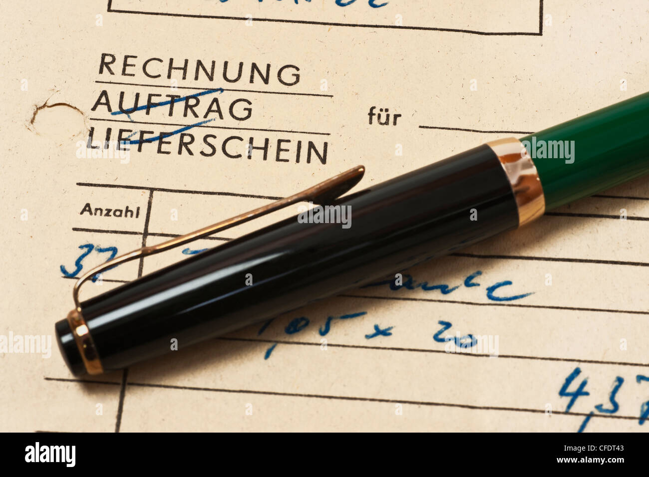 old invoice from 1970, German language and a fountain pen - Stock Image