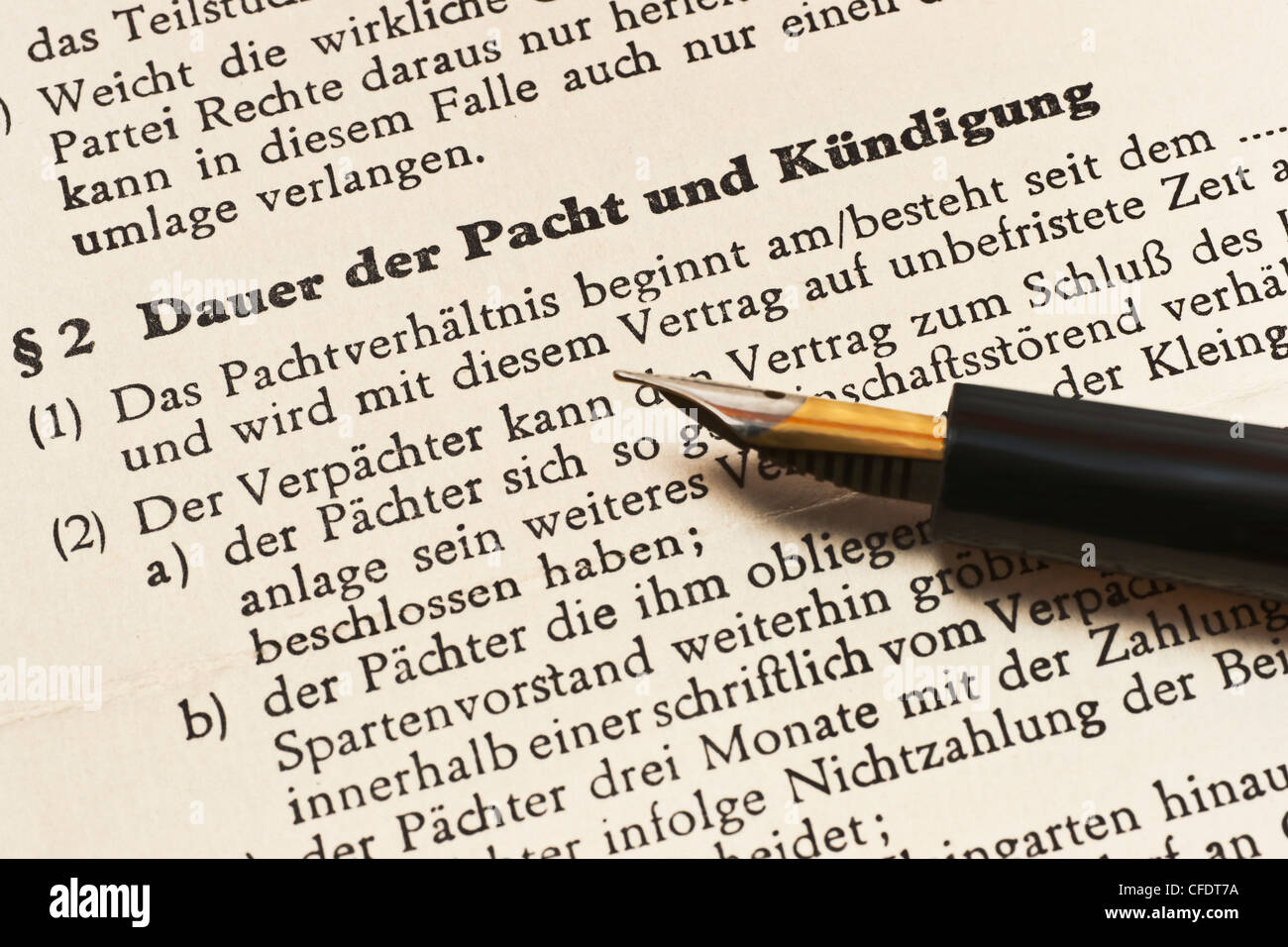 old lease contract from 1968, German language, duration of the lease and cancellation, alongside is a fountain pen. - Stock Image