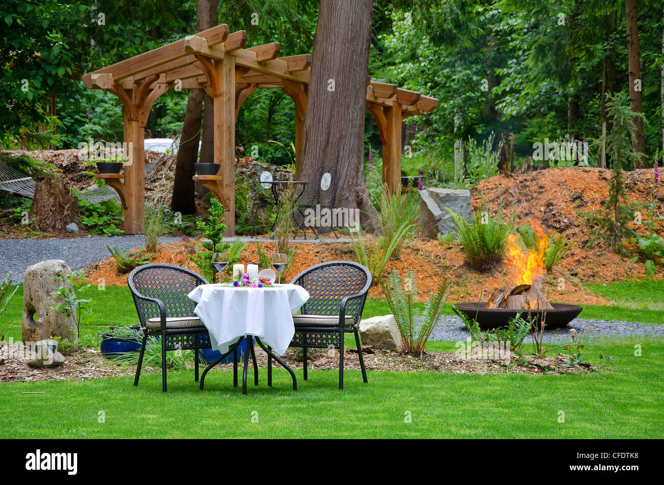 Romantic fireside dinner awaits guests Savary - Stock Image