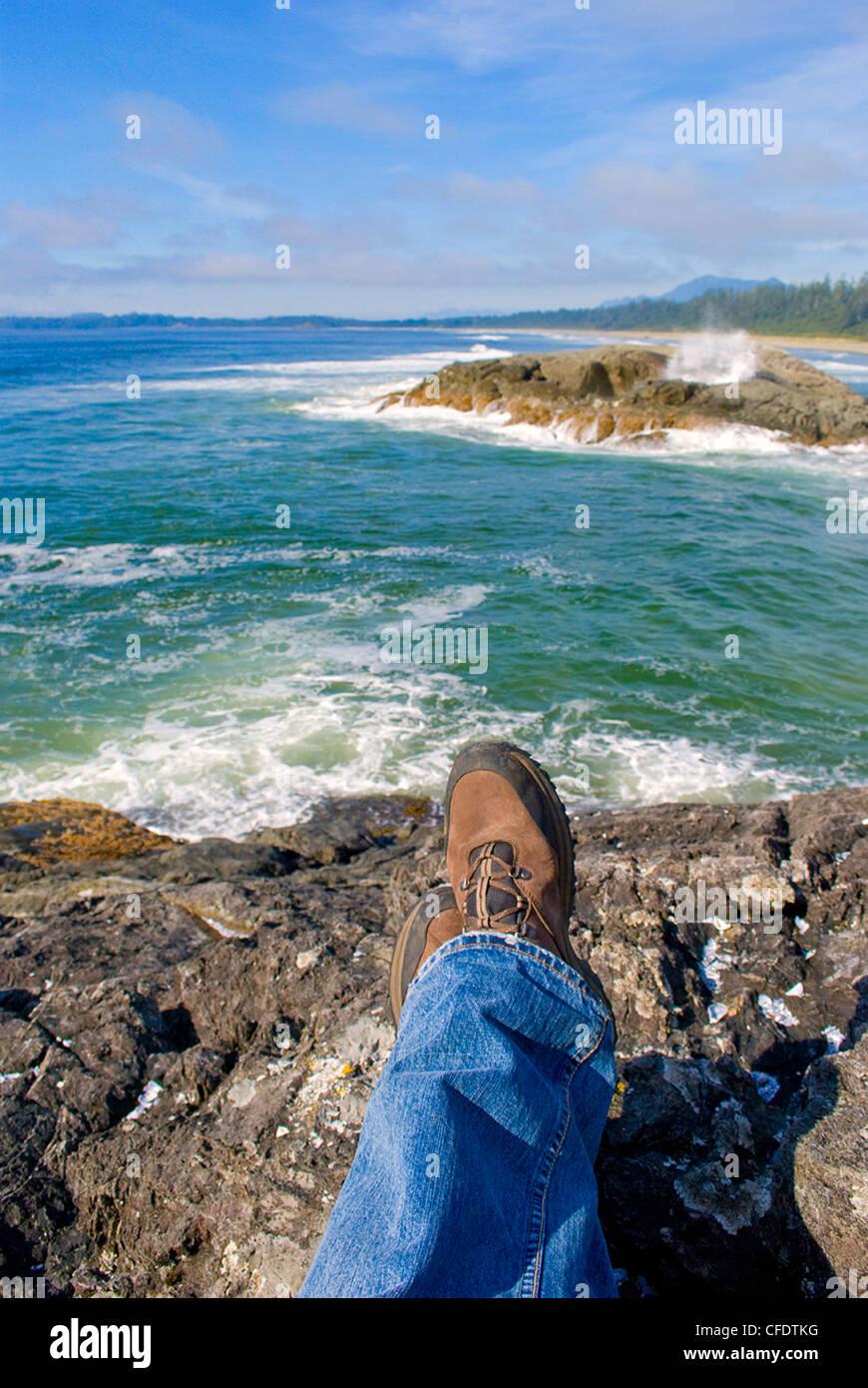Photographers view waves crashing Long Beach near - Stock Image