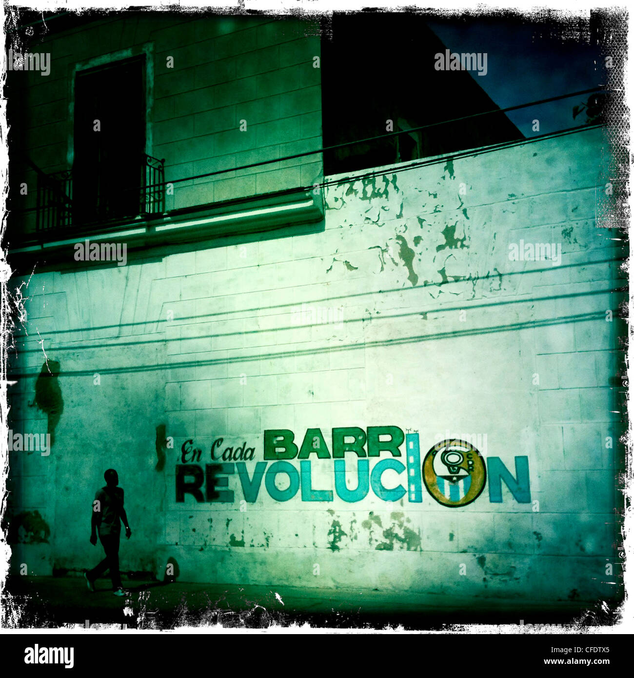 Mural celebrating the Revolution with lone figure walking, Cienfuegos, Cuba, West Indies, Caribbean, Central America - Stock Image
