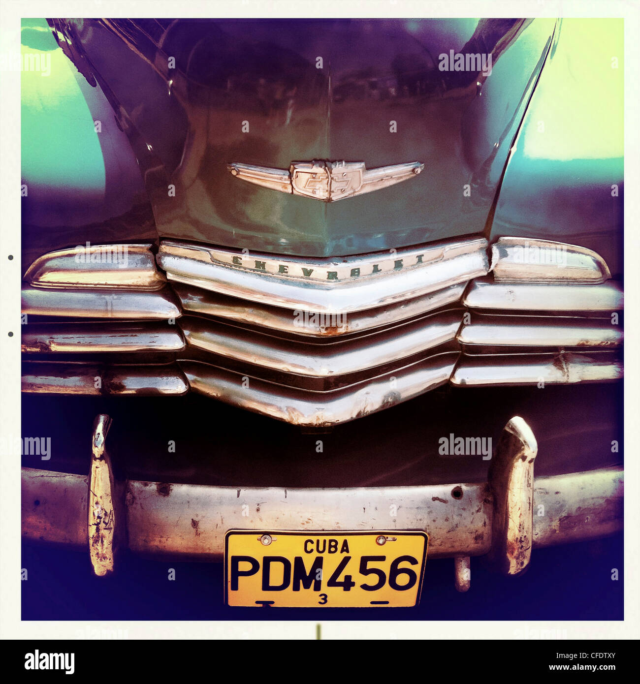 Detail of the front of an old green Chevrelet showing the chrome grill and numberplate, Vinales, Cuba, West Indies - Stock Image