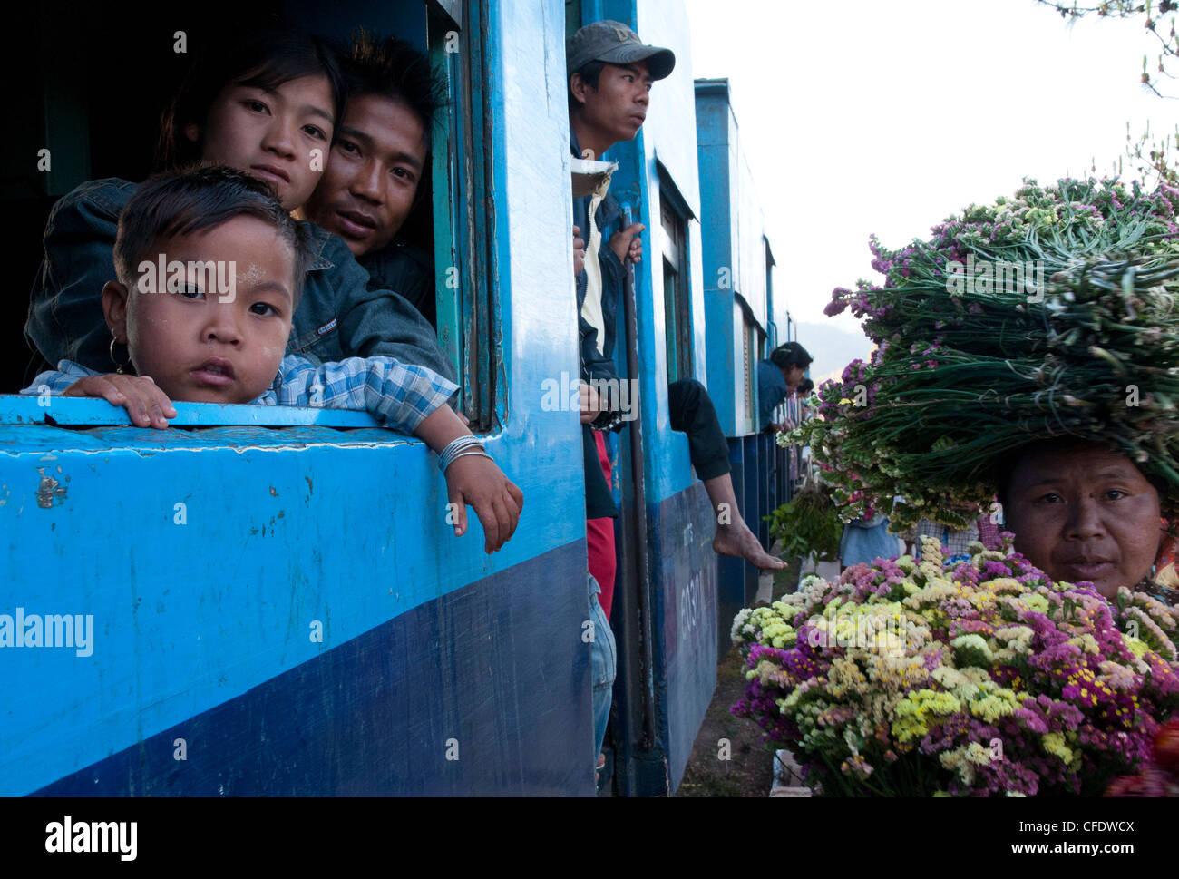 Vendors and passengers at Mindayik train station, Thazi to Shwenyaung train line, Myanmar, Asia - Stock Image