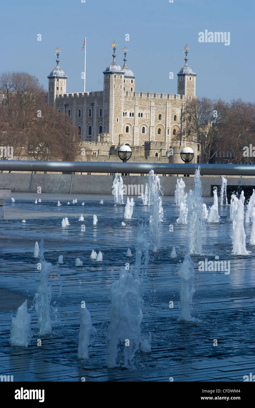 The Tower of London, through fountains on the South Bank of the River Thames, near the GLC Building, London SE1, - Stock Image
