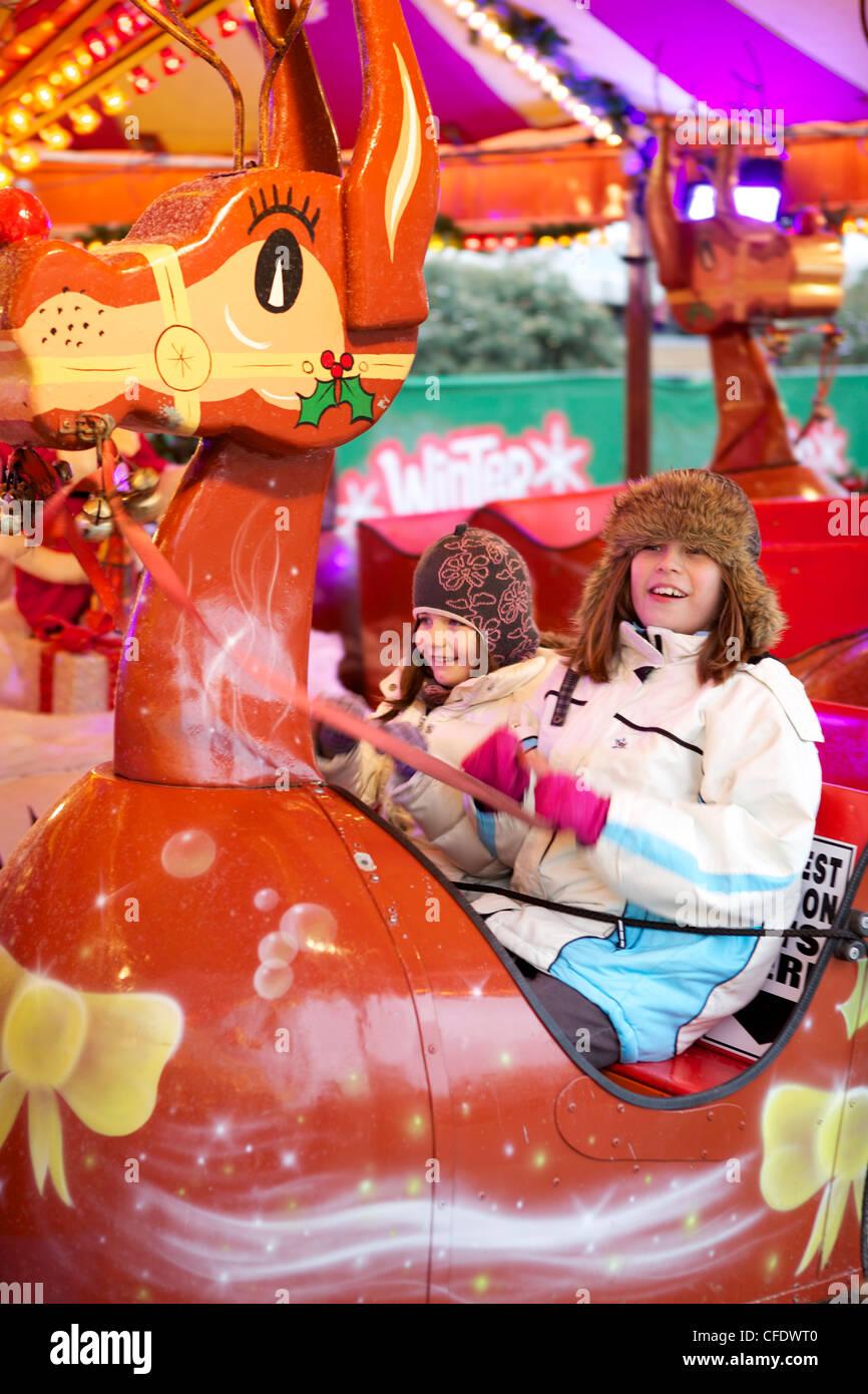 Children enjoying the rides at,Wonderland, Hyde Park, London, England, United Kingdom, Europe (Panning) - Stock Image