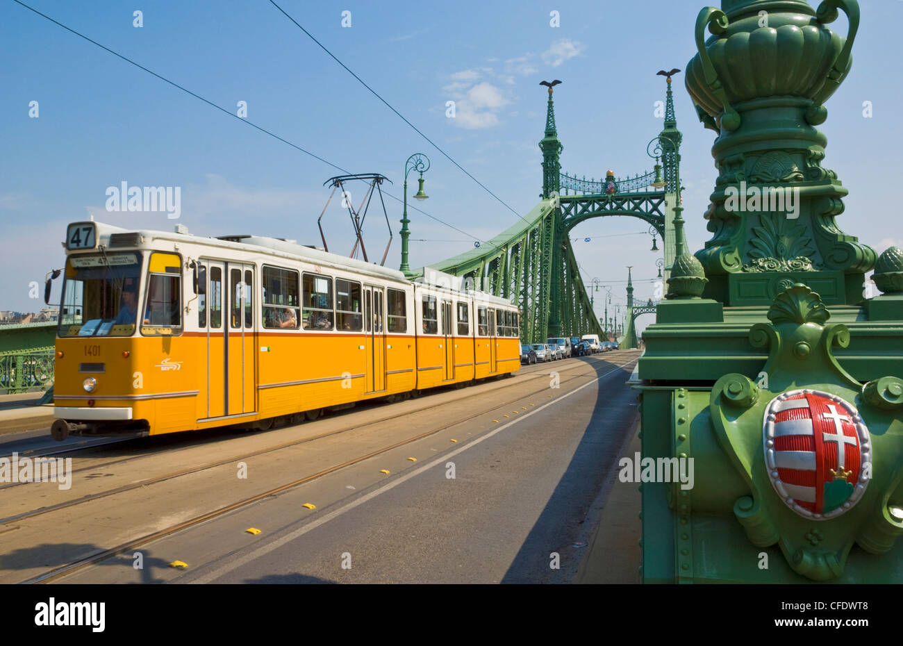 Yellow tram on The Liberty Bridge (Szabadsag hid), over the Rver Danube, Vamhaz Korut street, Budapest, Hungary, - Stock Image