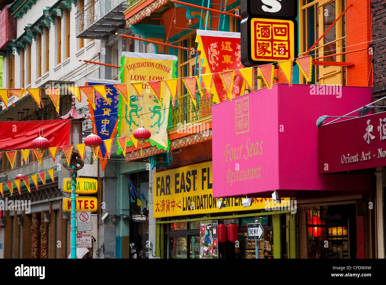 Colourful flags, banners and shopfronts in Chinatown, San Francisco, California, United States of America, - Stock Image