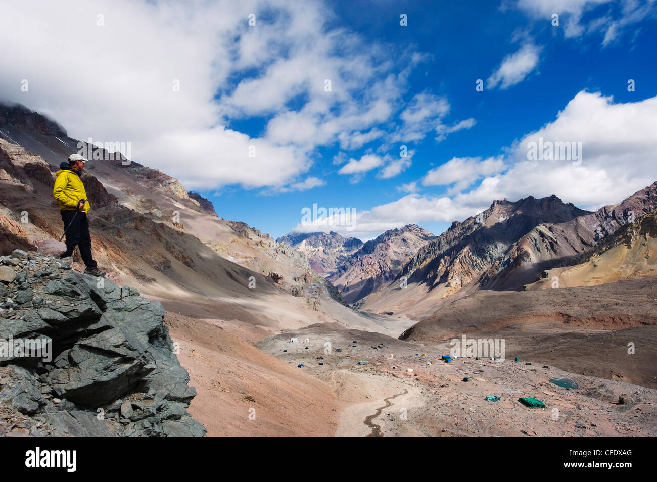 Hiker looking down to base camp, Plaza de Mulas, Aconcagua Provincial Park, Andes mountains, Argentina, South America - Stock Image