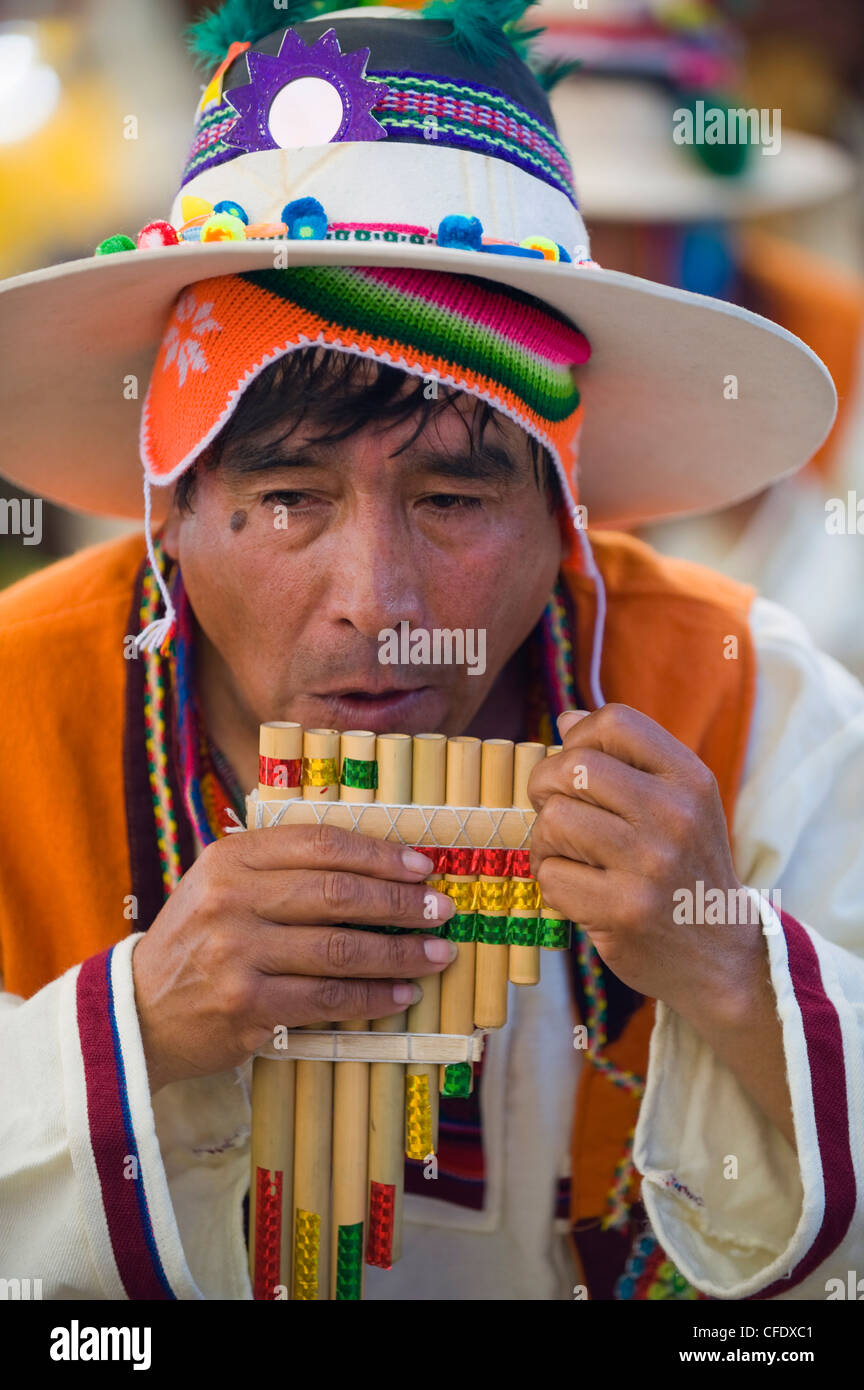 Musician playing the flute during Oruro Carnival, Oruro, Bolivia, South America - Stock Image