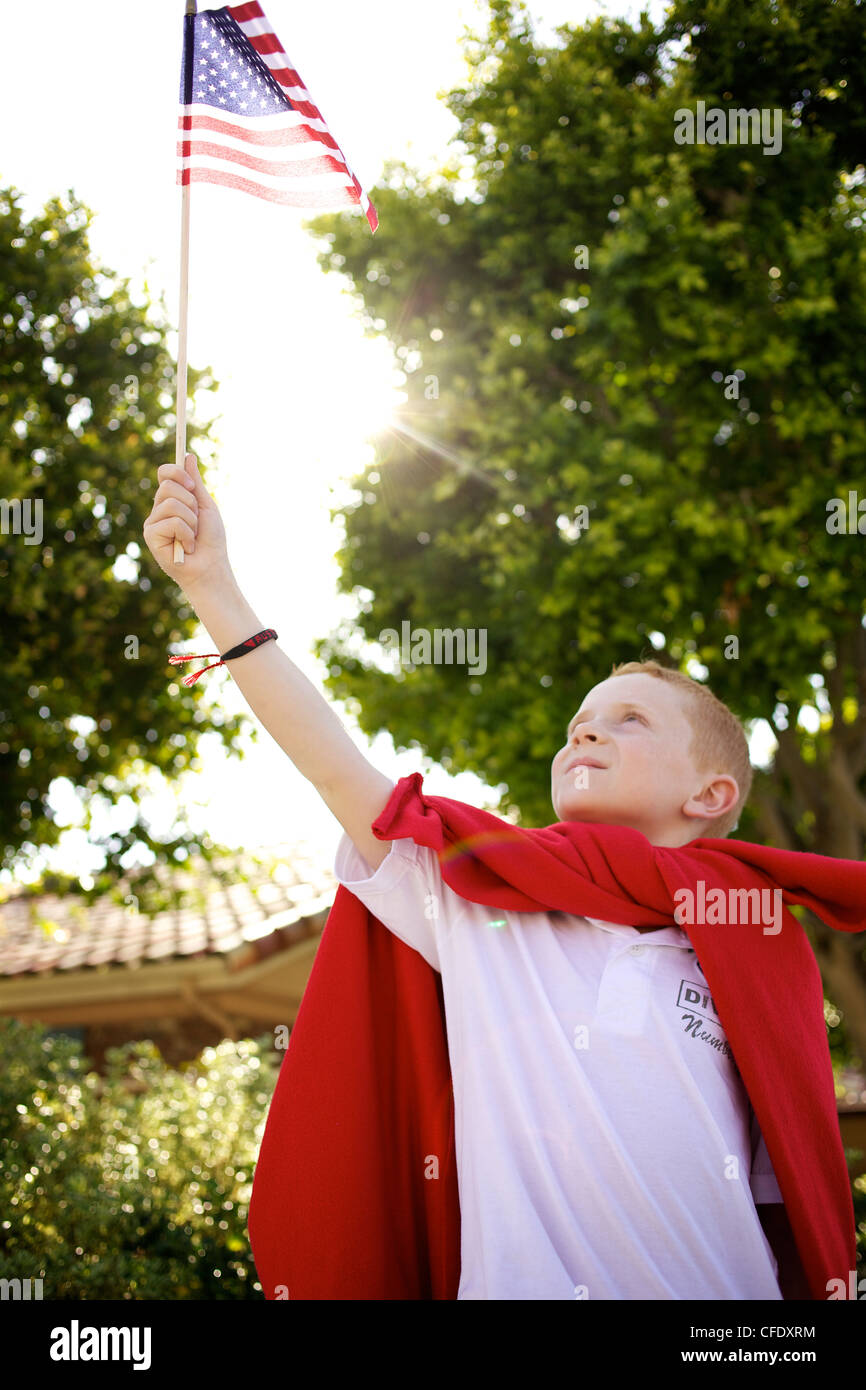 Patriotic Boy with American Flag - Stock Image