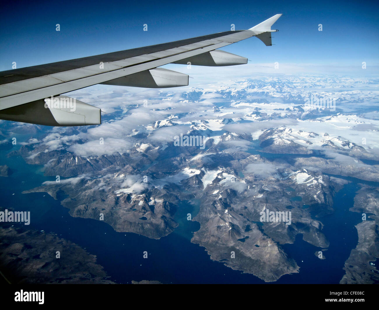 View from a window of an Airbus 320 Commercial Airliner Wing over Greenland - Stock Image