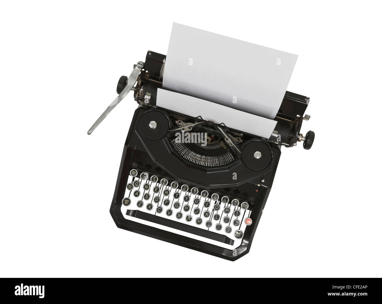 Vintage typewriter with blank paper isolated on white. Stock Photo