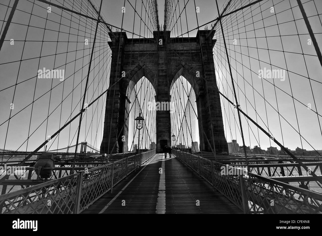 Black and white of the world famous Brooklyn Bridge walkway - Stock Image