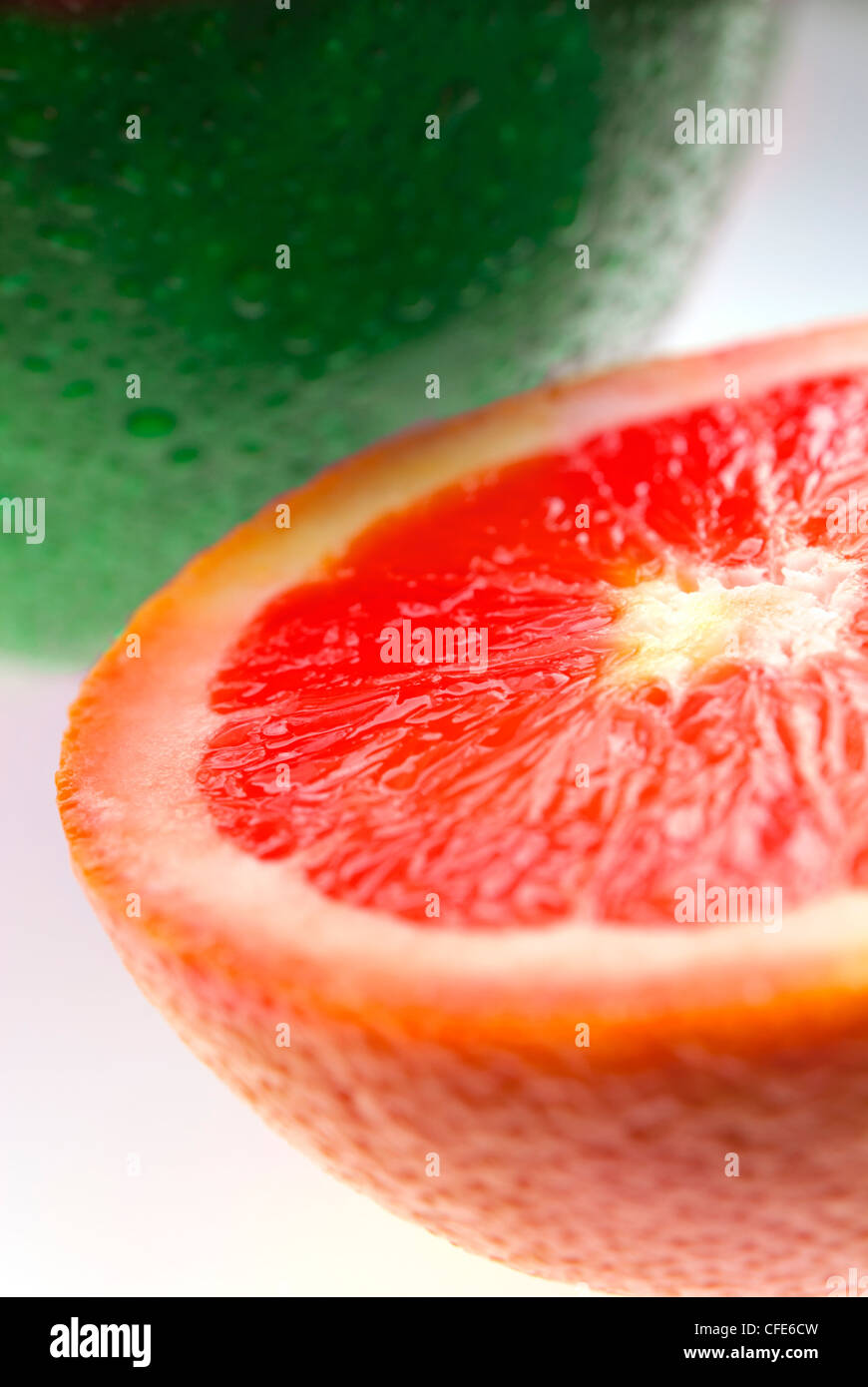 Close up of green apple and grapefruit isolated on white - Stock Image