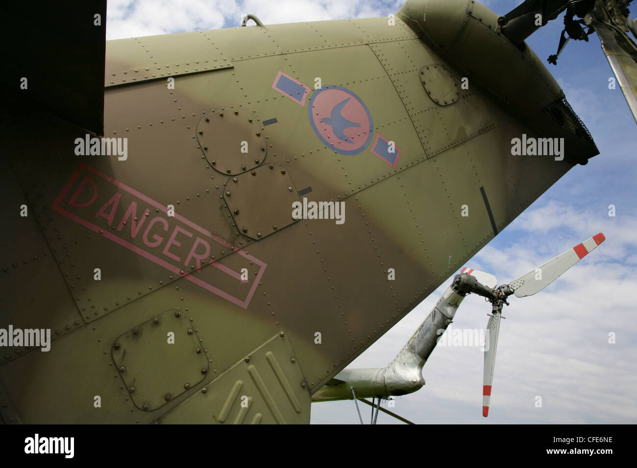 Tailplanes and tail rotors of old military helicopters. - Stock Image