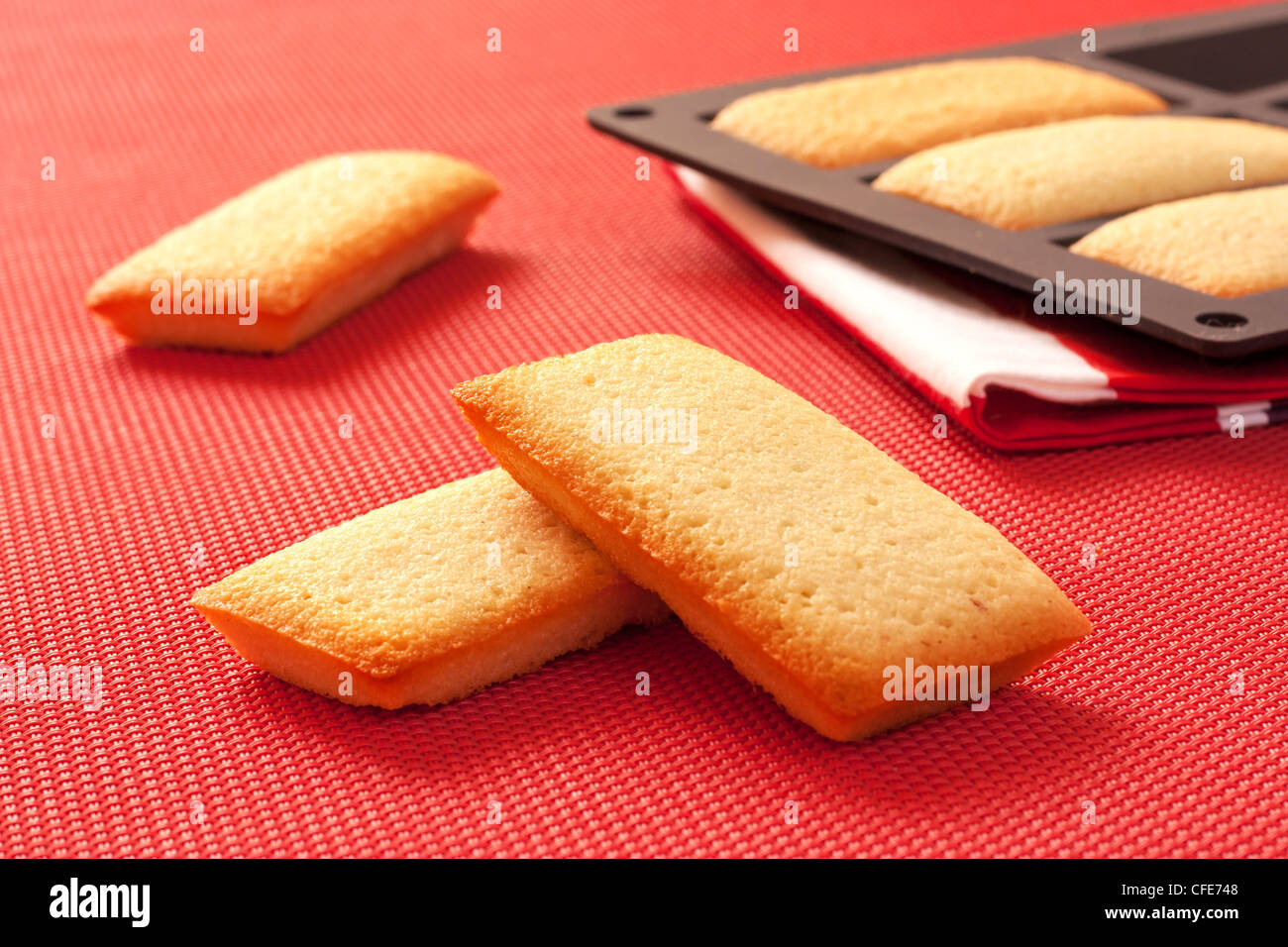 French biscuits called Financiers, with almond powder, smooth inside and crispy on the edges - Stock Image