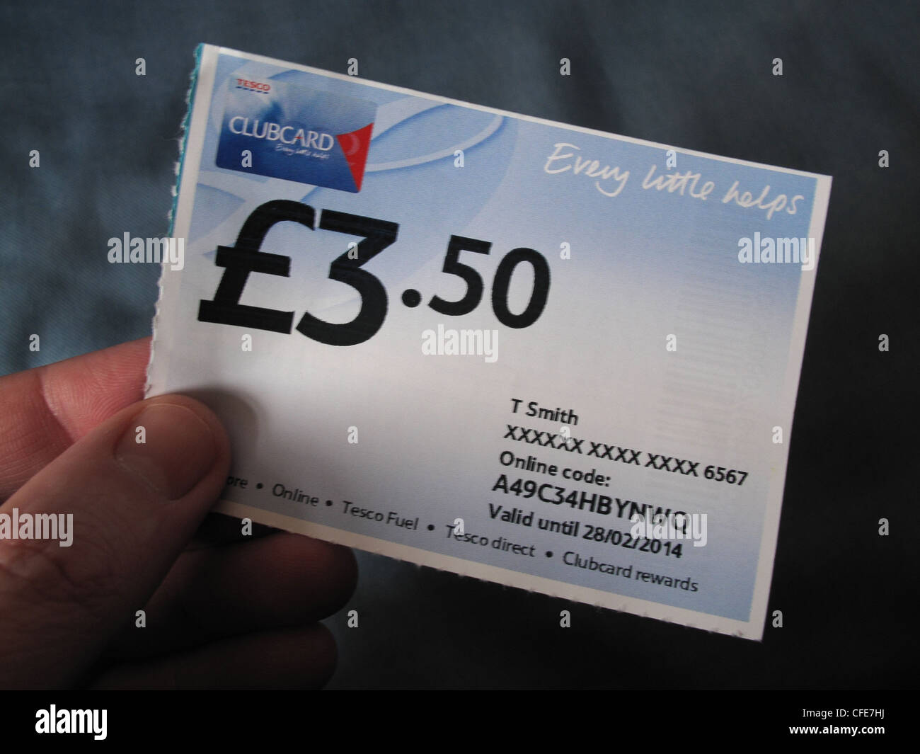 £3.50 Tesco Clubcard 'Every Little Helps' voucher held in a hand by a shopper - Stock Image