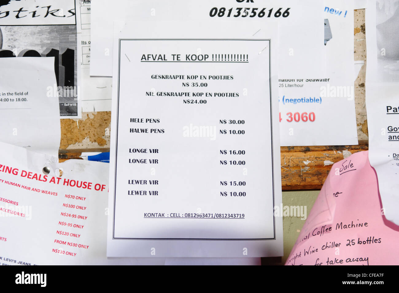 Notice board in a supermarket adverting offal, in Afrikaans language. Luderitz, Namibia. - Stock Image