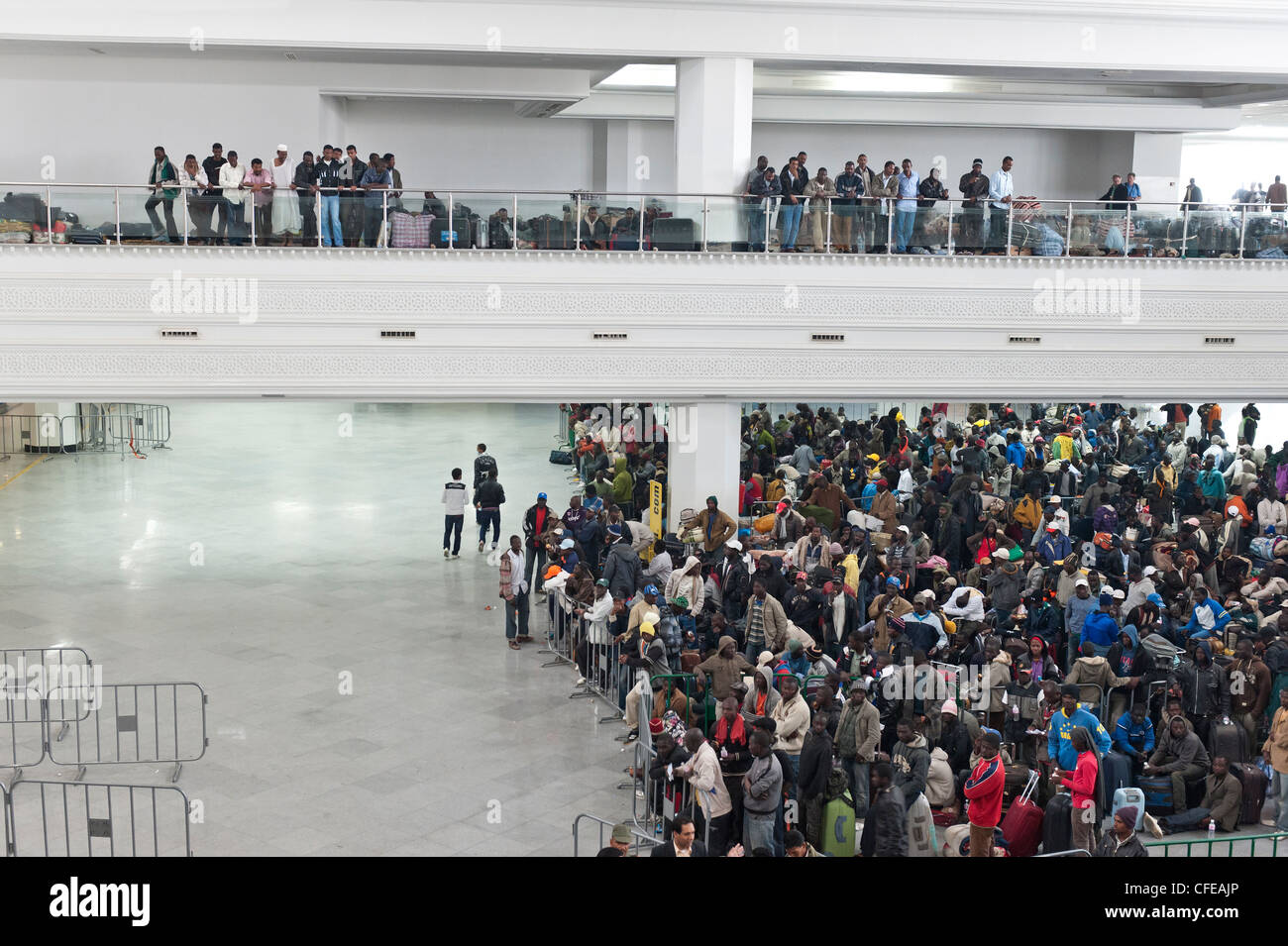 Djerba Airport. Tunisia.  Around 15000  refugees evacuated from Libya waiting for planes to take them back home. - Stock Image
