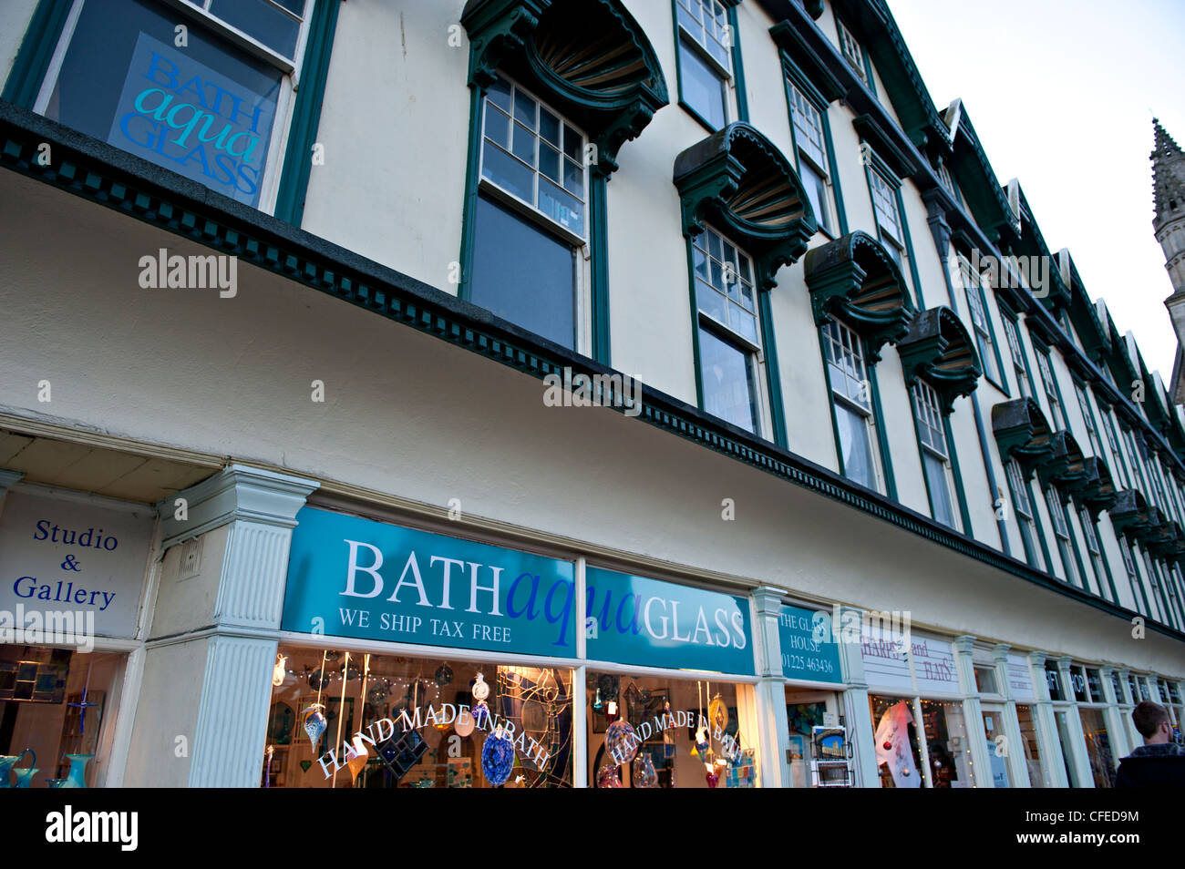 Shopfronts and residential buildings in Bath, UK - Stock Image