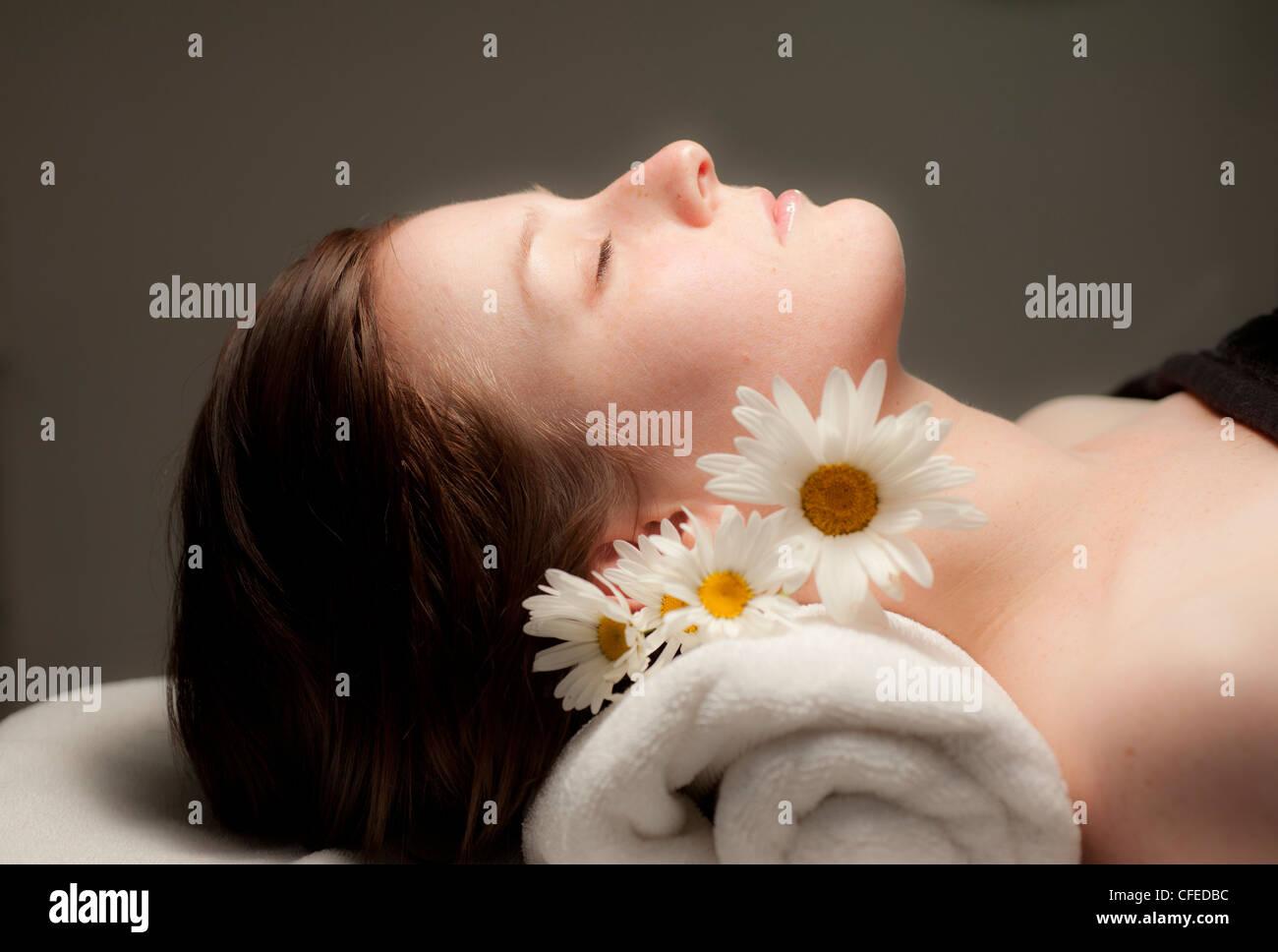 woman receiving facial at spa - Stock Image