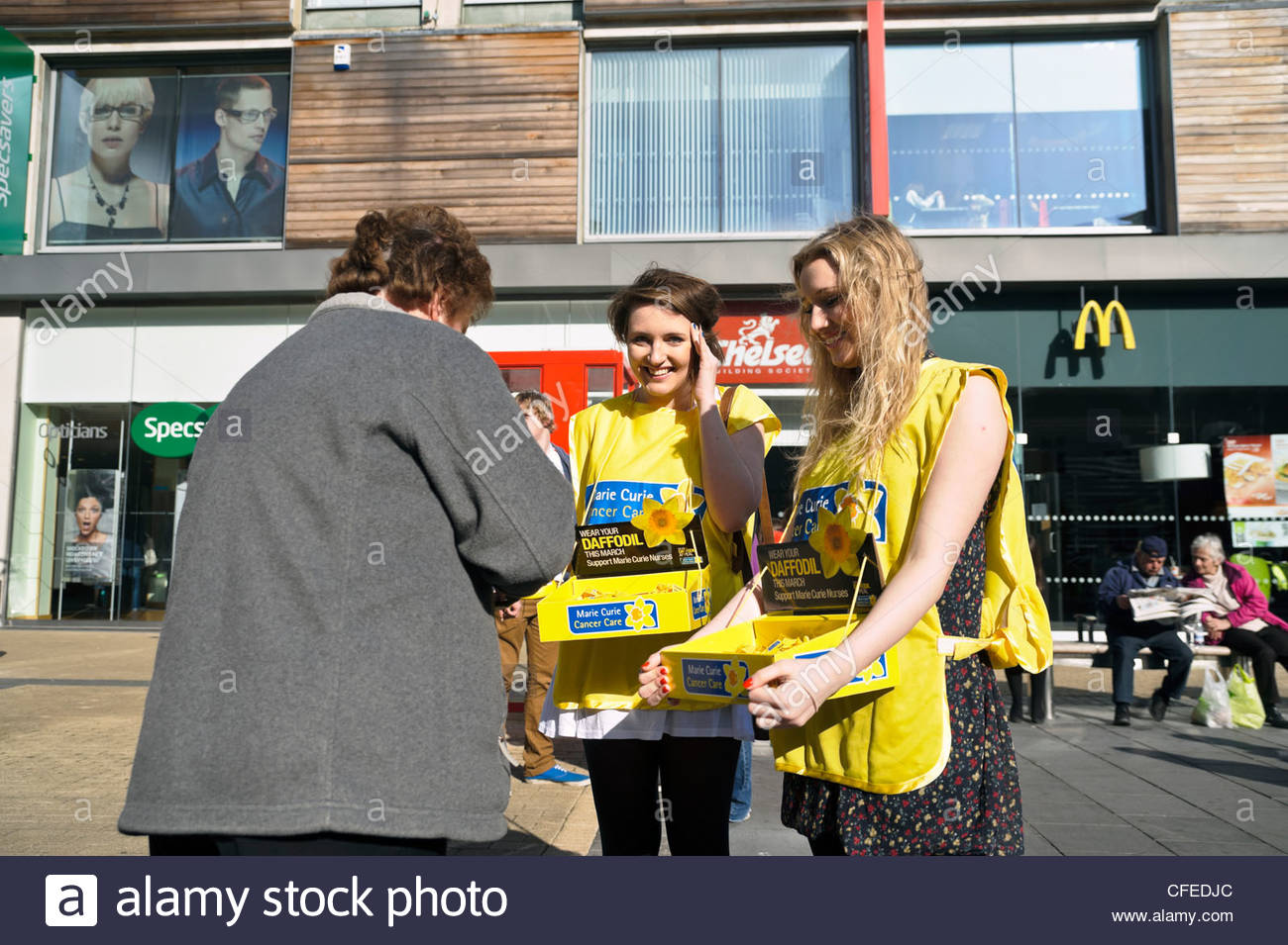 Marie Curie charity street collection, Bristol City Center, UK. Two teenage girls collecting money for the Marie - Stock Image