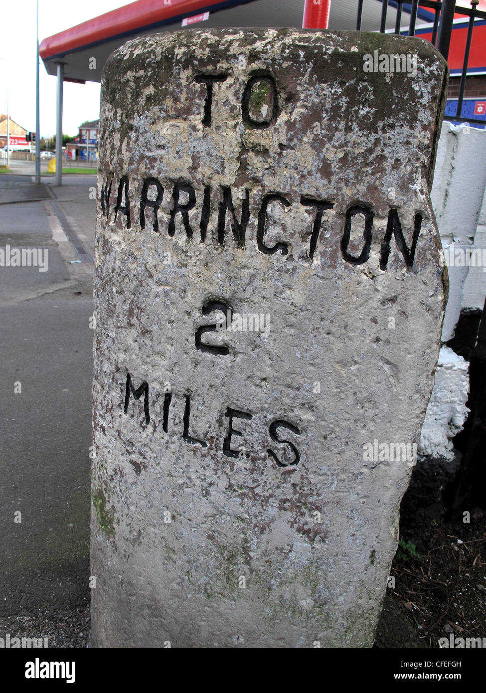 Milepost To Warrington 2 Miles, on A57 at Liverpool Road, Penketh, Cheshire, England UK - Stock Image
