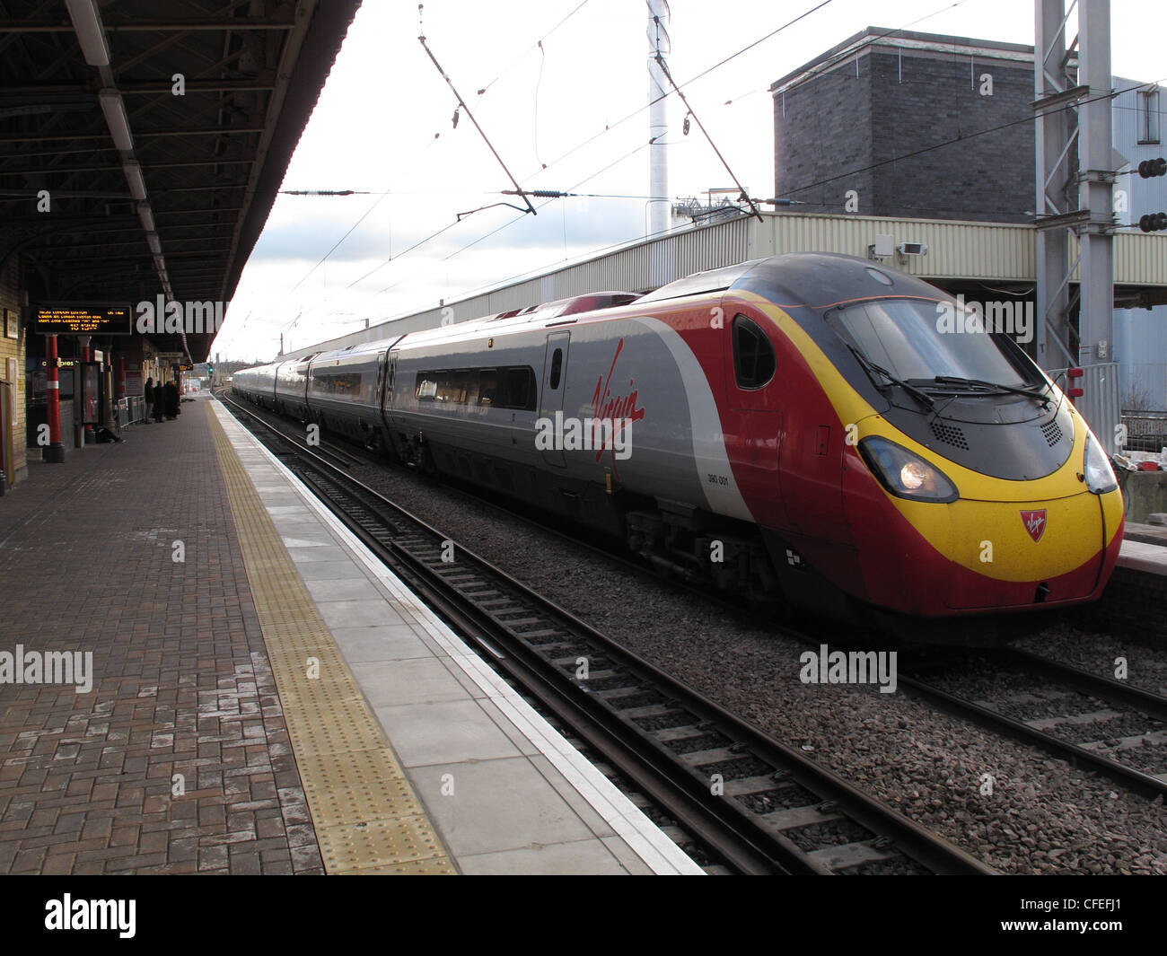 Virgin Voyager intercity train arrives at Warrington Bank Quay Railway Station. Looking south. - Stock Image