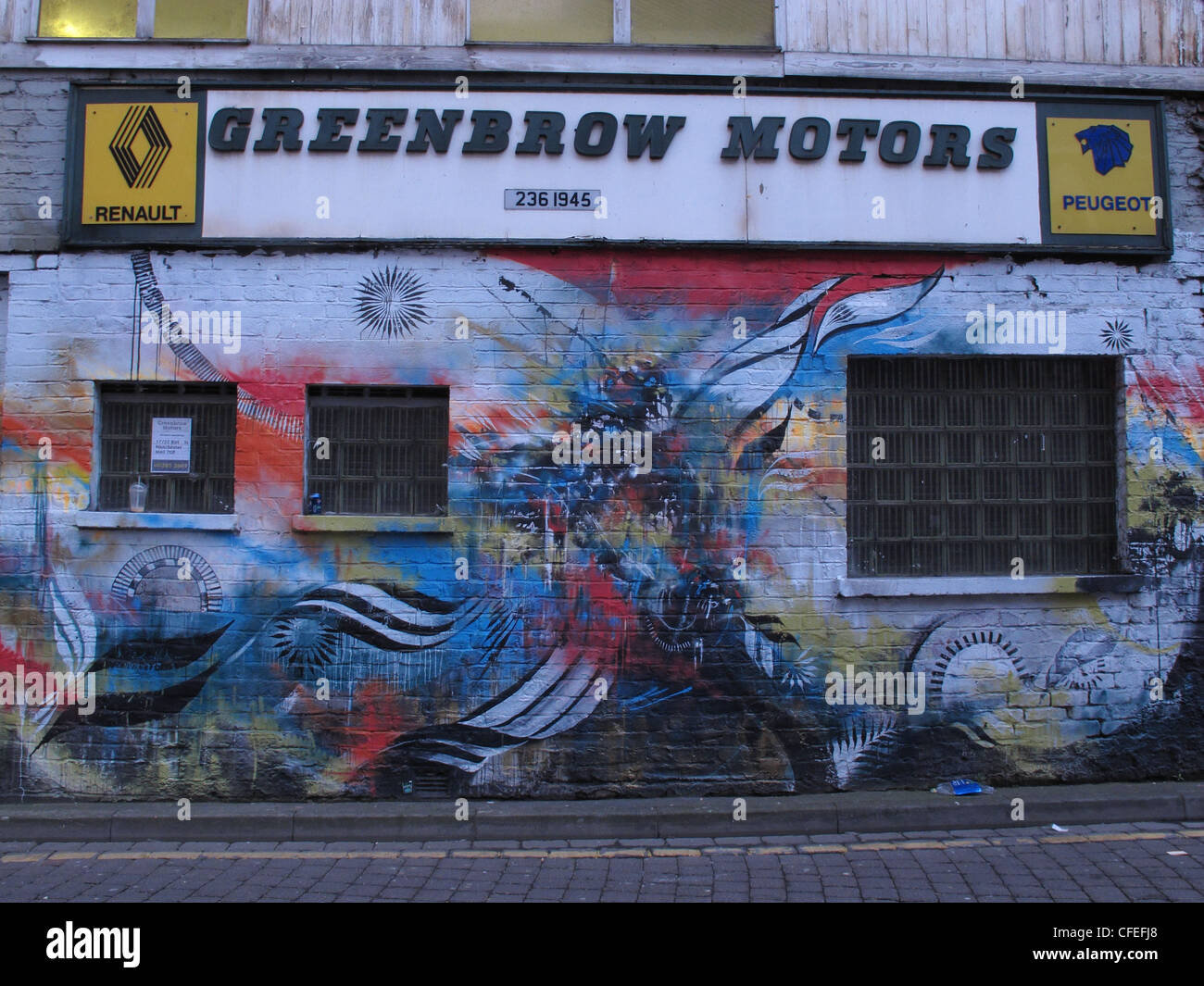 Inner city Manchester graffiti at Greenbow Motors 51 New Wakefield St - Stock Image