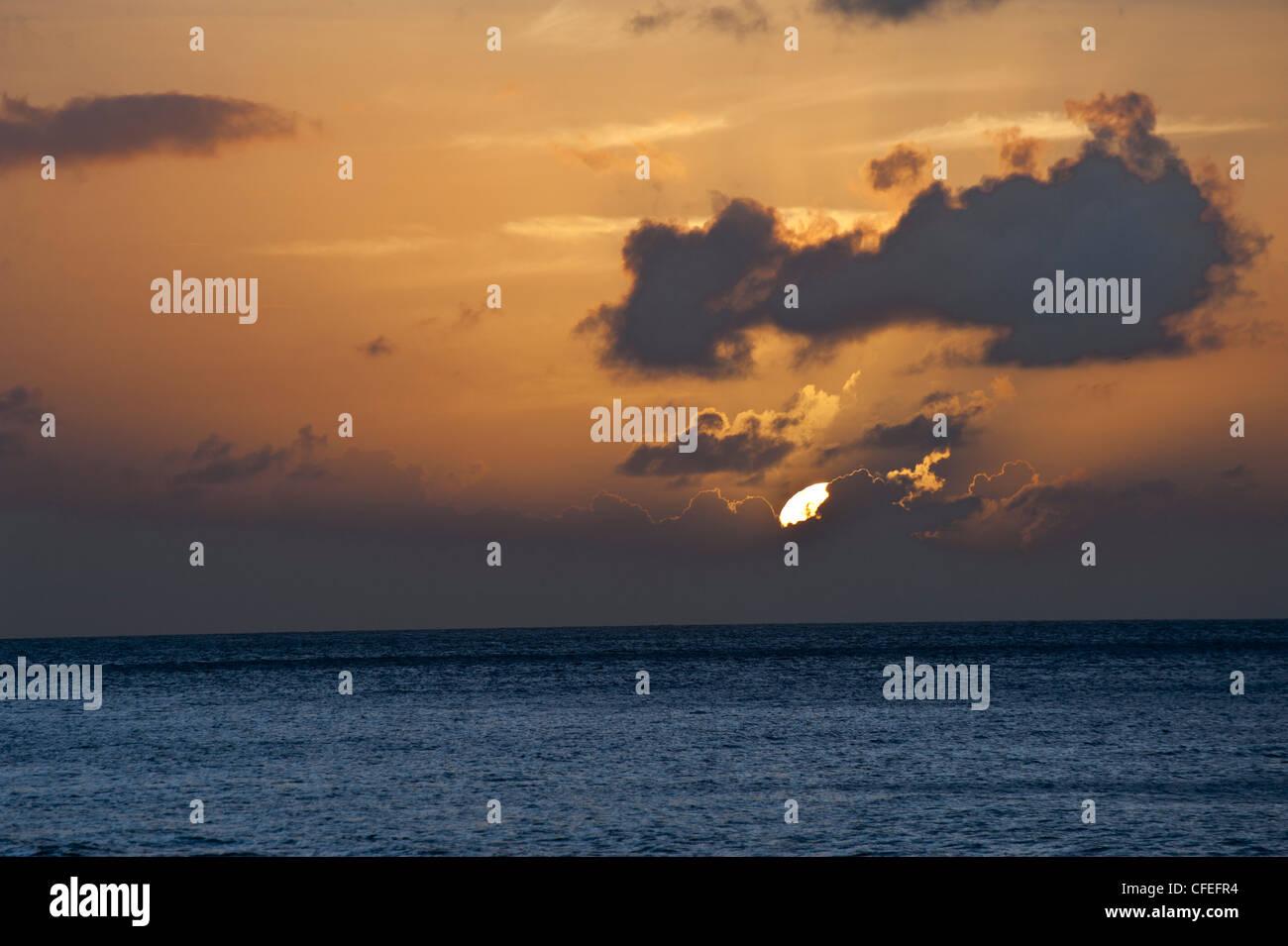 Dramatic Sunset in Grand Case, Saint Martin (French Saint-Martin; Dutch: Sint Maarten) an island in the northeast - Stock Image