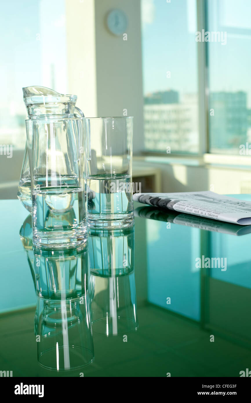 Workplace with glassware and newspaper Stock Photo