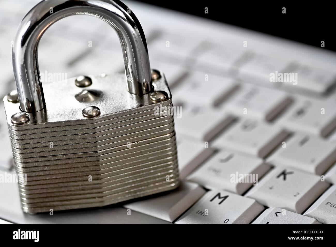 locked padlock on computer keyboard - Stock Image