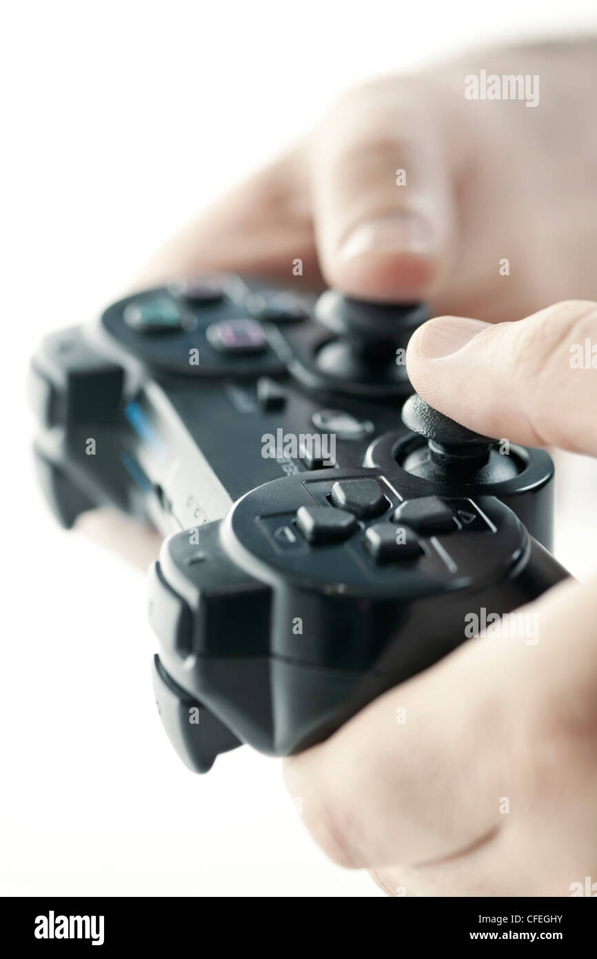 Male hands holding video game controller closeup - Stock Image