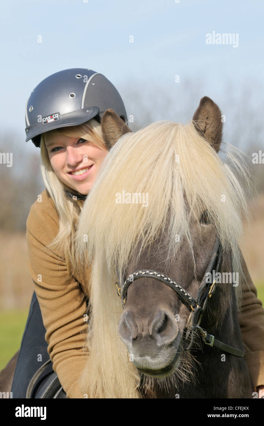 Young woman and her Icelandic horse stallion - Stock Image