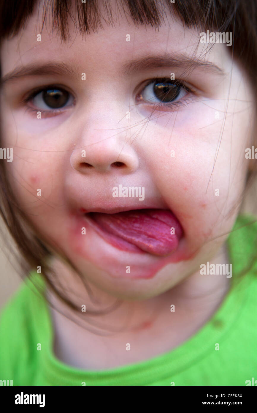 Girl with messy red mouth - Stock Image