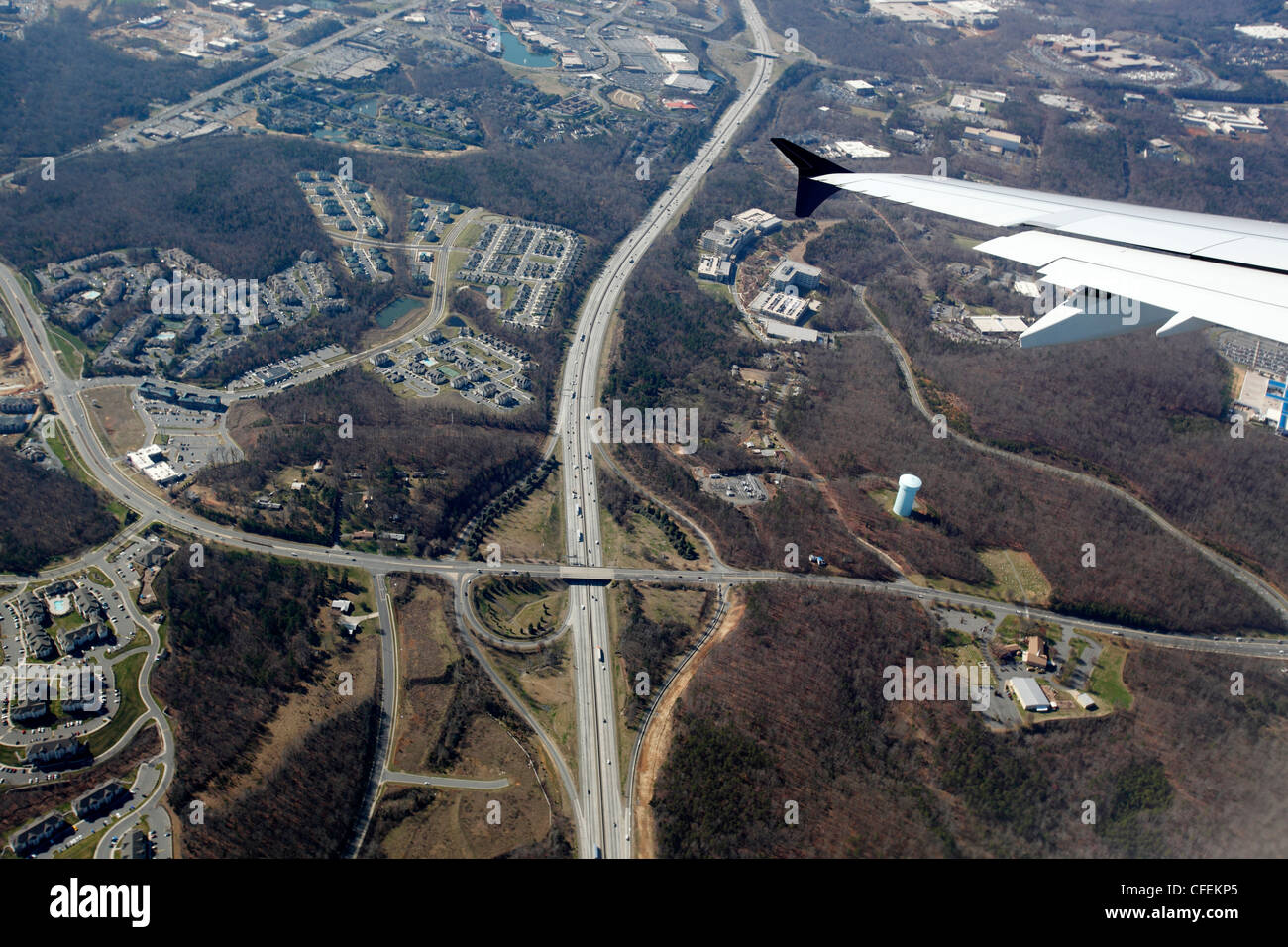 Highway interchange as jet takes off from Fort Lauderdale-Hollywood International Airport in Florida, USA - Stock Image