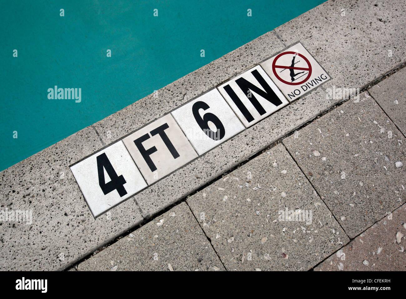 swimming pool depth numbers - Stock Image