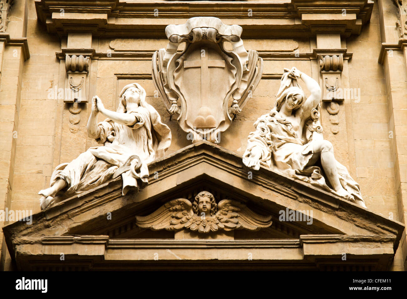 Detail of a pediment above a doorway Florence Italy - Stock Image